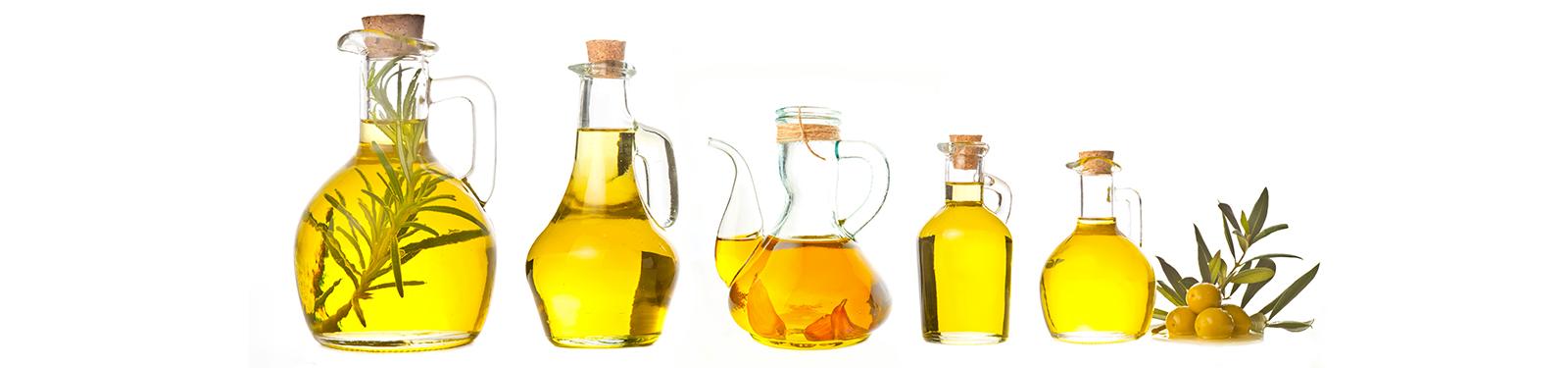 Bouteilles ouvragées d'huiles